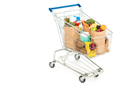 Photo for grocery bags in shopping trolley isolated on white - Royalty Free Image