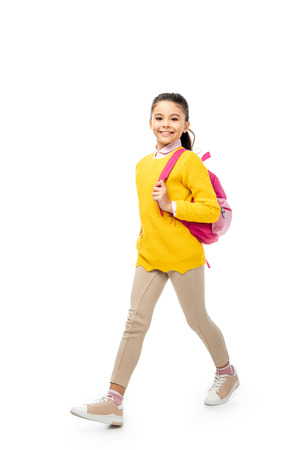 Foto de adorable child walking and smiling at camera isolated on white - Imagen libre de derechos