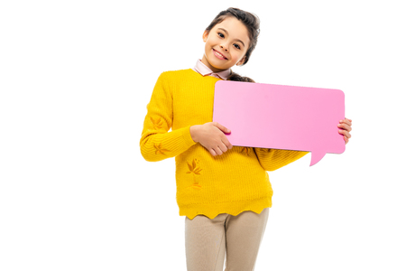 Photo pour cheerful schoolgirl holding pink speech bubble and looking at camera isolated on white - image libre de droit
