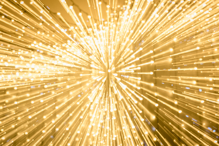 long exposure of blurred shiny golden bokeh lights