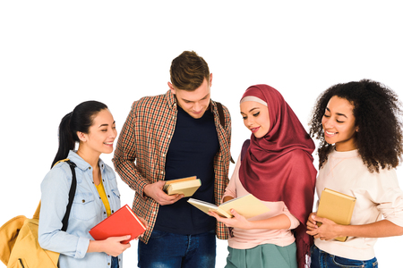 Photo pour cheerful multiethnic group of young people reading book isolated on white - image libre de droit