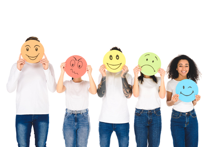 Foto de young multicultural friends in white t-shirts holding signs with face expressions isolated on white - Imagen libre de derechos