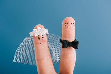 Foto de cropped view of happy wedding couple of fingers isolated on blue - Imagen libre de derechos