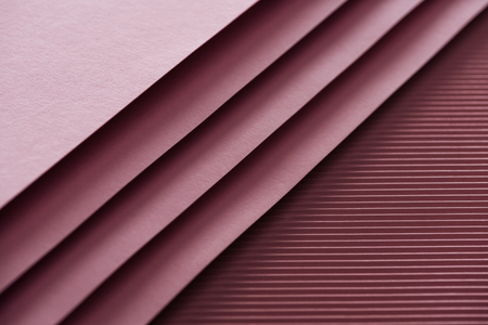 Photo pour top view of blank and pink sheets of paper on burgundy background with copy space - image libre de droit