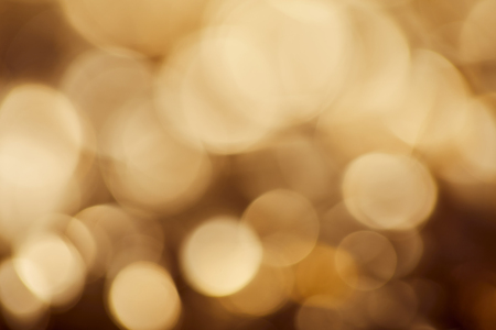 Foto per bright brown background with golden sparkling lights - Immagine Royalty Free