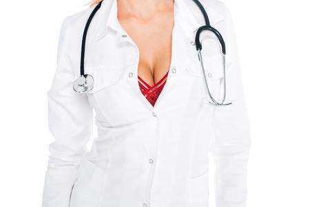 Foto de cropped view of nurse in coat, red underwear with stethoscope isolated on white - Imagen libre de derechos