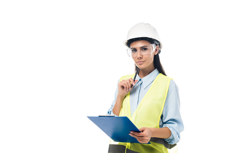 Photo pour Engineer in hardhat holding clipboard isolated on white - image libre de droit