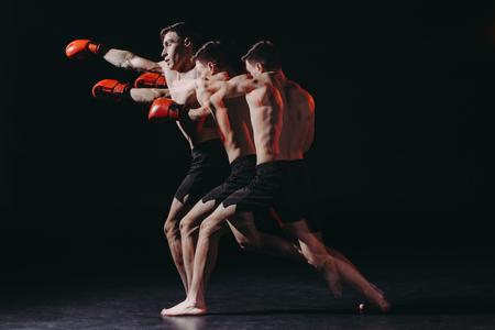 Foto de sequence shot of shirtless muscular boxer in boxing gloves doing punch - Imagen libre de derechos