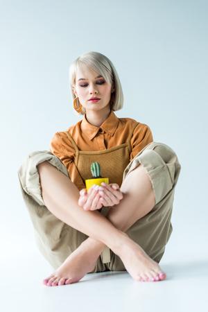 Photo for beautiful stylish girl holding cactus plant on white - Royalty Free Image