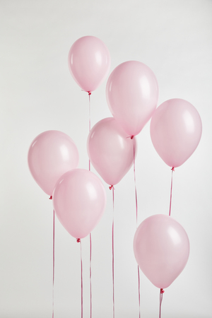 Photo pour background with pink festive balloons isolated on white - image libre de droit