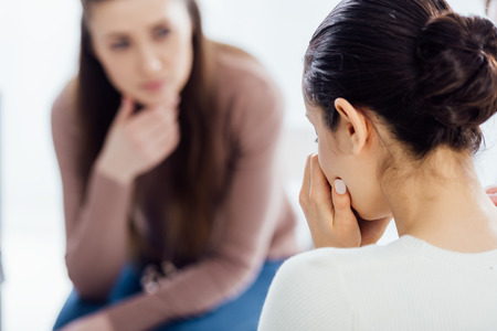 Photo pour back view of woman crying during therapy session with copy space - image libre de droit