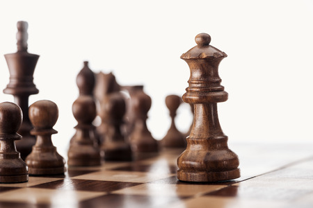 Photo pour selective focus of wooden chessboard with chess figures isolated on white - image libre de droit