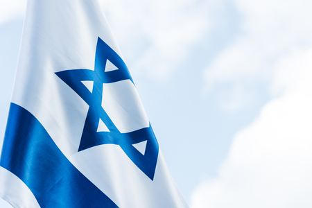 Photo pour national flag of israel with blue star of david against sky with clouds - image libre de droit