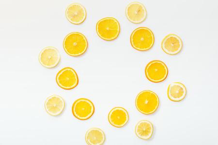 Photo pour Flat lay with juicy cut fruits on white surface - image libre de droit