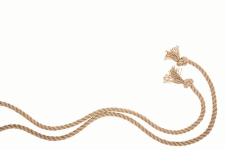 Foto de waved brown and jute ropes isolated on white - Imagen libre de derechos