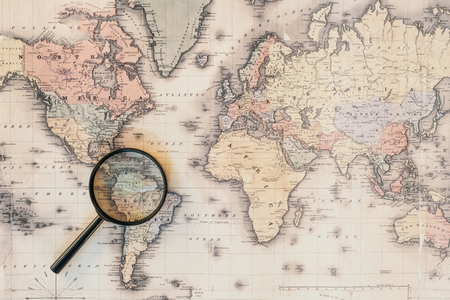 Photo pour Top view of magnifying glass on world map - image libre de droit