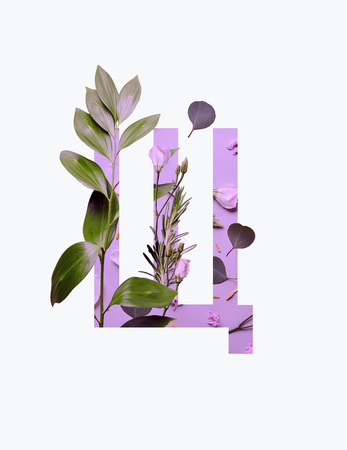 Foto de Cyrillic letter with green leaves on light purple background isolated on white - Imagen libre de derechos