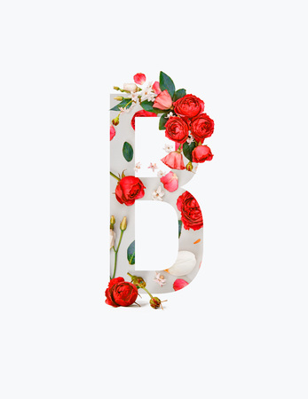 Foto de Cyrillic letter with red roses and green leaves isolated on white background - Imagen libre de derechos