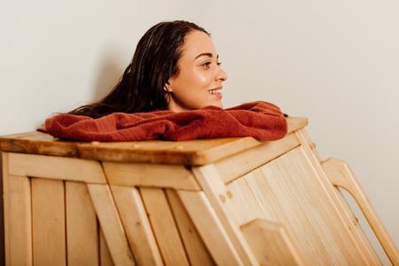Photo pour smiling woman taking steam bath in spa center - image libre de droit