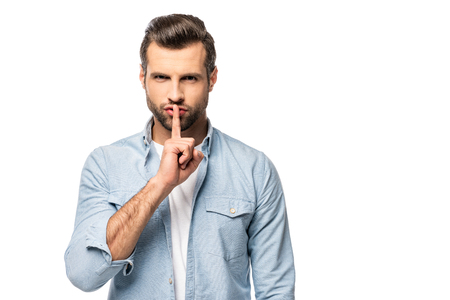 Foto de man with finger on mouth Isolated On White with copy space - Imagen libre de derechos