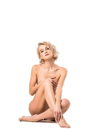 Photo pour Beautiful naked blonde young woman looking at camera isolated on white background with copy space - image libre de droit
