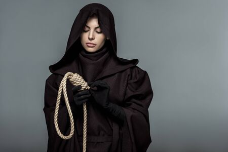 Photo for Woman in death costume holding hanging noose isolated on grey background - Royalty Free Image