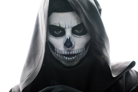 Photo pour Front view of woman with skull makeup looking at camera isolated on white background - image libre de droit
