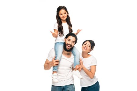 Photo for happy latin father carrying on shoulders cute daughter showing thumbs up near happy wife isolated on white - Royalty Free Image