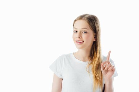 Photo pour happy teenage girl showing idea gesture and looking at camera isolated on white - image libre de droit