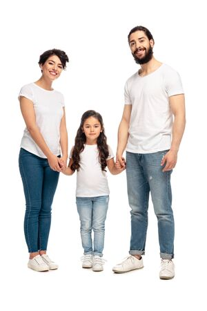 Photo pour latin parents holding hands with adorable daughter isolated on white - image libre de droit