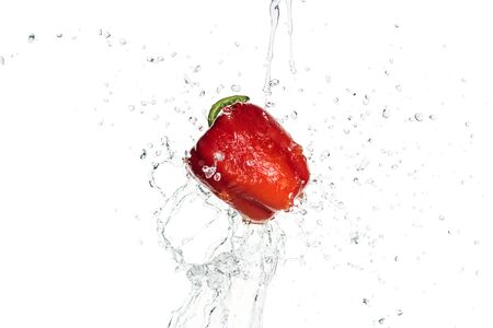 Photo pour whole tasty red bell pepper with clear water splash isolated on white - image libre de droit