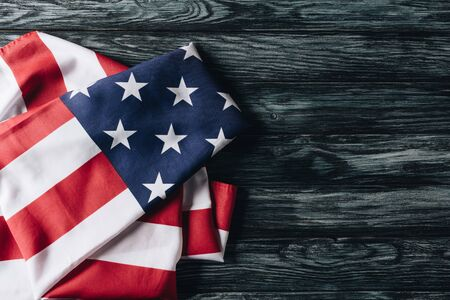Photo pour folded flag of united states of america on grey wooden surface, memorial day concept - image libre de droit