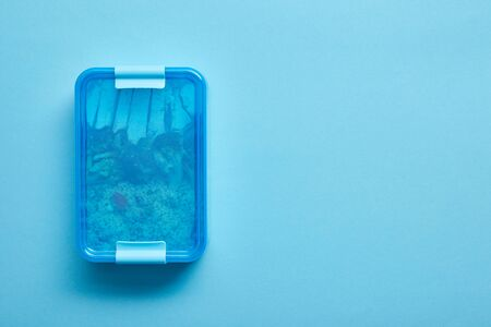Photo for Top view of lunch box with delicious healthy meal on blue background - Royalty Free Image