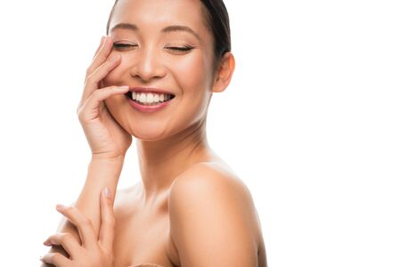 Photo pour Cheerful naked Asian woman with perfect skin, isolated on white background - image libre de droit