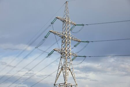Photo pour low angle view of electric pole on grey cloudy background - image libre de droit