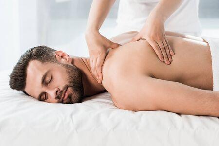 Photo pour handsome bearded man lying on massage table during massage - image libre de droit