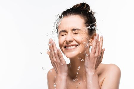Foto per happy naked young woman with natural beauty washing up with clean water splash isolated on white - Immagine Royalty Free