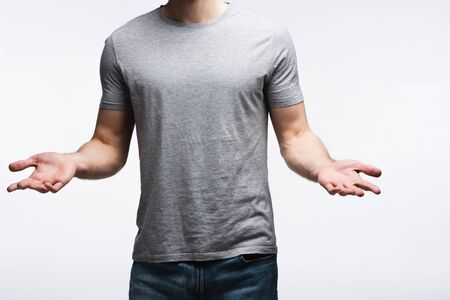 Photo pour partial view of man showing shrug gesture isolated on grey, human emotion and expression concept - image libre de droit