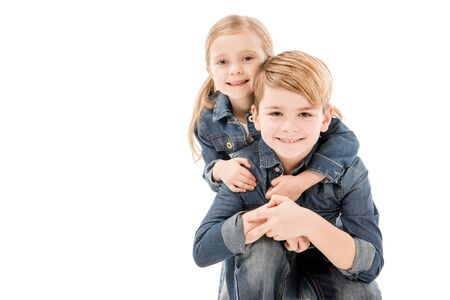 Photo for happy kids embracing and looking at camera isolated on white - Royalty Free Image