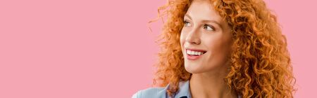 Photo pour attractive redhead cheerful girl isolated on pink - image libre de droit