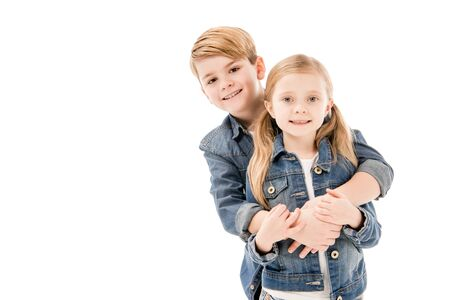 Photo pour happy kids embracing and looking at camera isolated on white - image libre de droit
