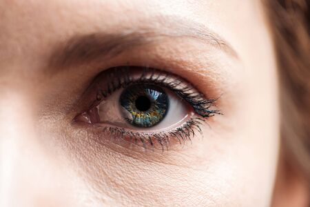 Photo pour close up view of young woman green eye with eyelashes and eyebrow looking at camera - image libre de droit
