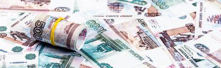 Photo pour panoramic shot of cash roll on russian money - image libre de droit