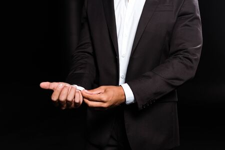 Photo for cropped view of mixed race man touching white shirt isolated on black - Royalty Free Image