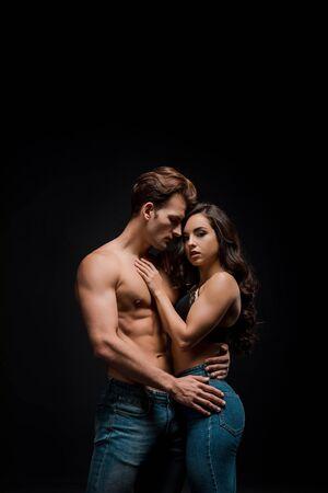 Foto de beautiful sensual couple hugging, isolated on black - Imagen libre de derechos