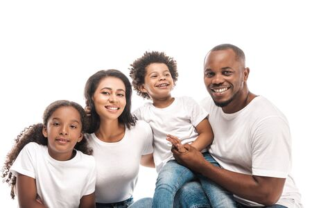 Photo pour happy african american family smiling at camera isolated on white - image libre de droit