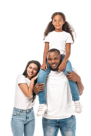Photo pour happy african american woman leaning on shoulder of husband piggybacking adorable daughter isolated on white - image libre de droit