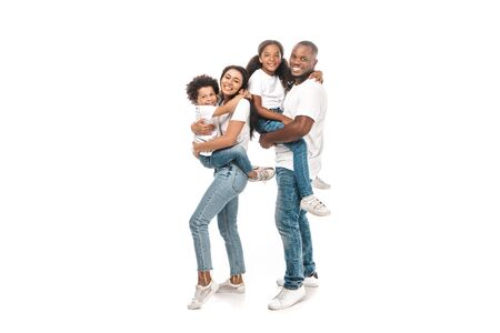 Foto de happy african american woman holding son, and husband holding daughter on white background - Imagen libre de derechos