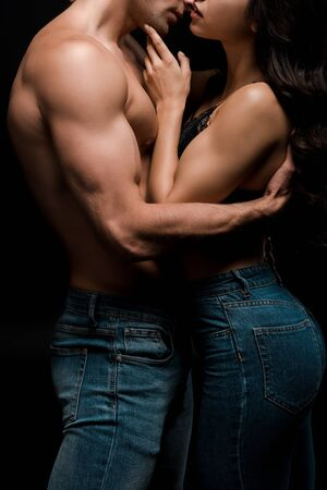 Photo for cropped view of sensual couple hugging together, isolated on black - Royalty Free Image