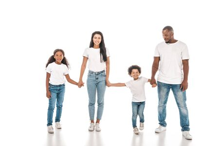 Foto de happy african american mother, father, daughter and son holding hands and smiling on white background - Imagen libre de derechos